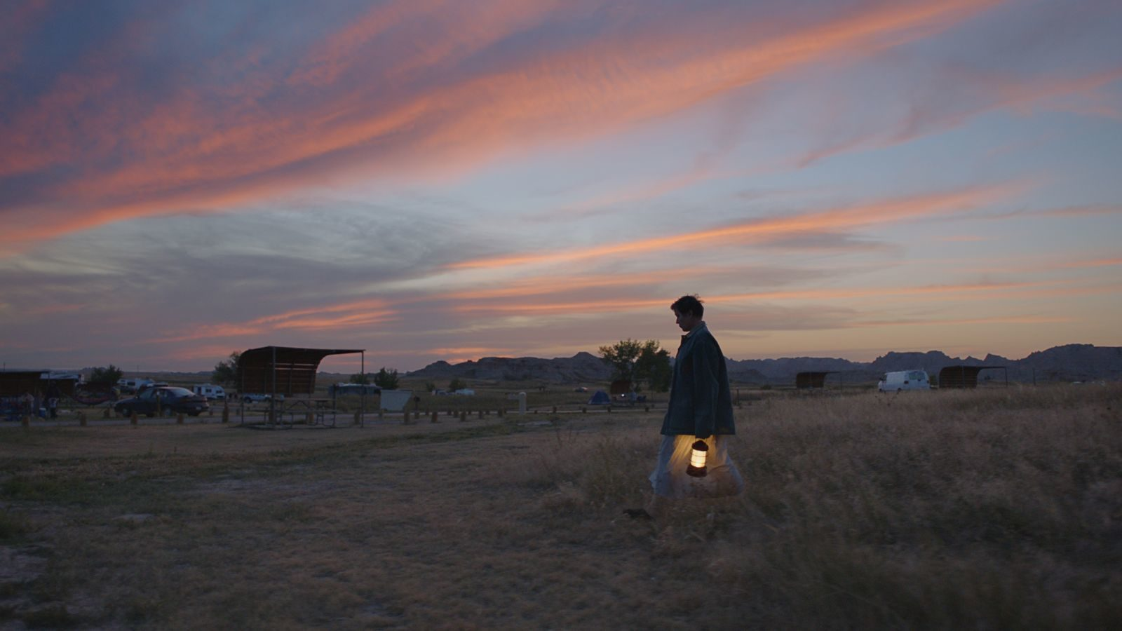 Frances McDormand wanders with a lantern in Chloe Zhao's film Nomadland