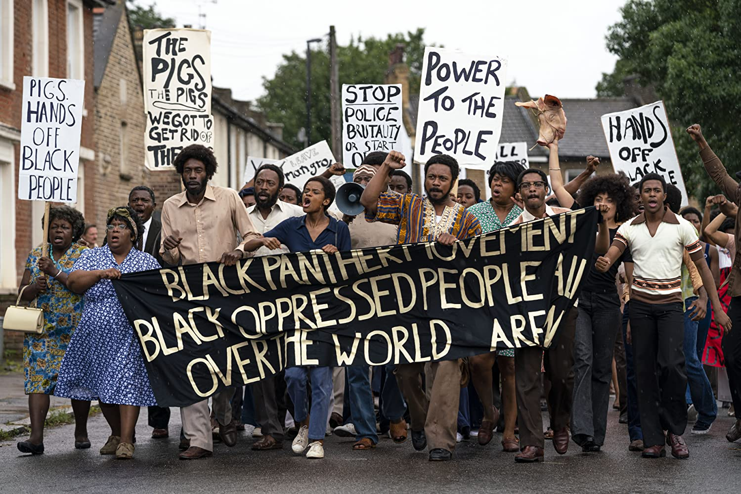 The cast of Steve McQueen's Mangrove (part of the Small Axe film anthology) protesting racism and police brutality